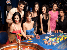 Beutiful people playing roulette dressed up in a casino