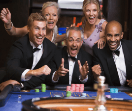 Happy, well-dressed gamblers winning at the roulette table