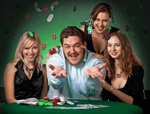 A high roller throwing casino chips in the air surrounded by beautiful women