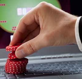 Casino chips on a computer symbolising online gambling