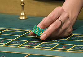 Placing a bet on the roulette table