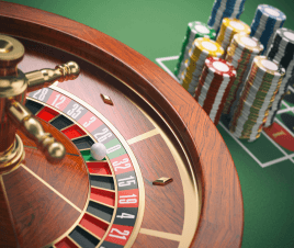 A roulette wheel and stacks of casino chips